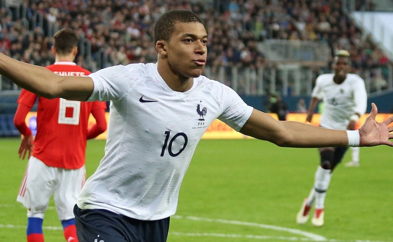 Kylian Mbappe celebrating his second goal for France on 27 March 2018.
