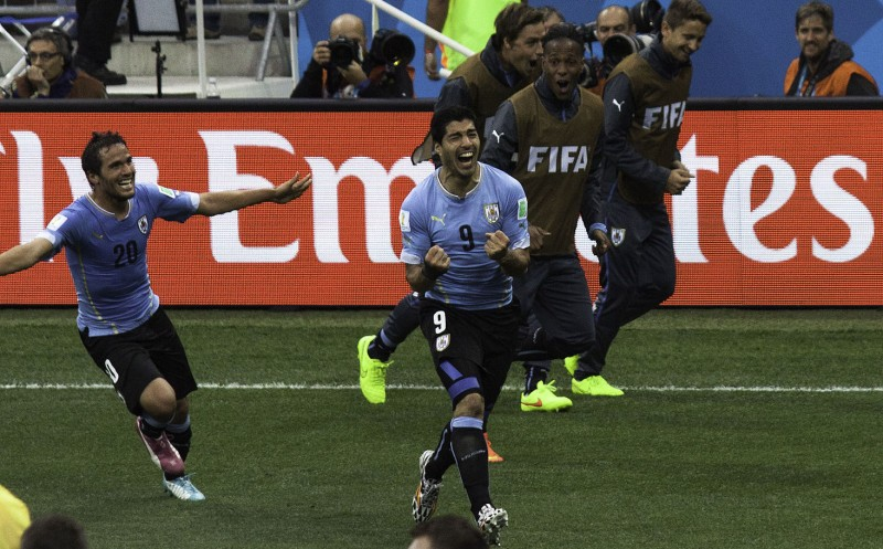 Suarez celebrates for Uruguay